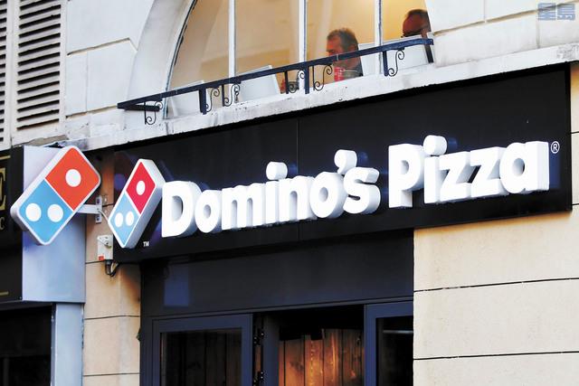 達美樂去年營收終於超越必勝客,成為美國披薩龍頭。路透社