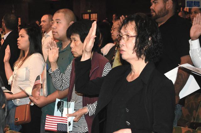 屋崙千人入籍宣誓現場,中國移民數量佔第一。記者徐明月攝