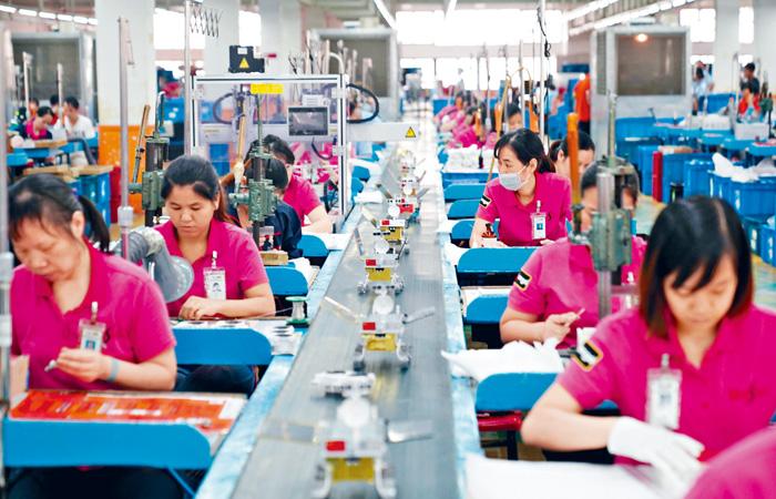 中國進出口企業面臨裁員壓力。路透社