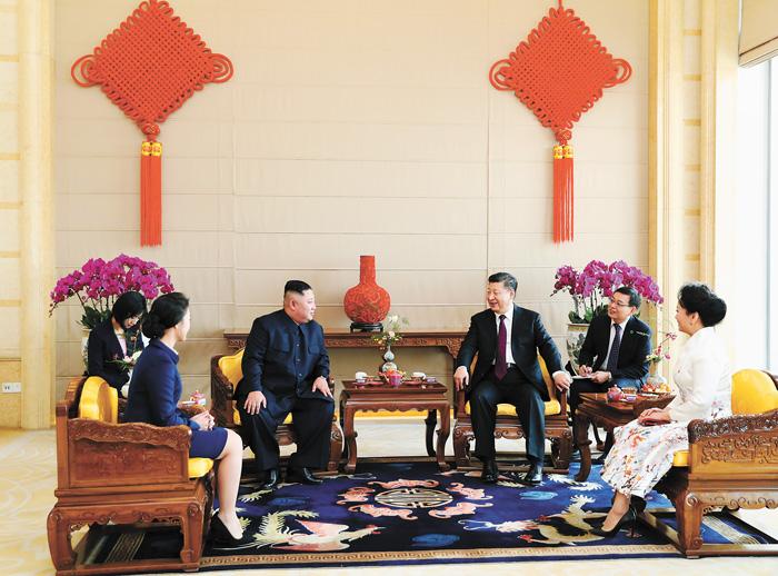 習近平夫婦在北京飯店會見金正恩夫婦。新華社