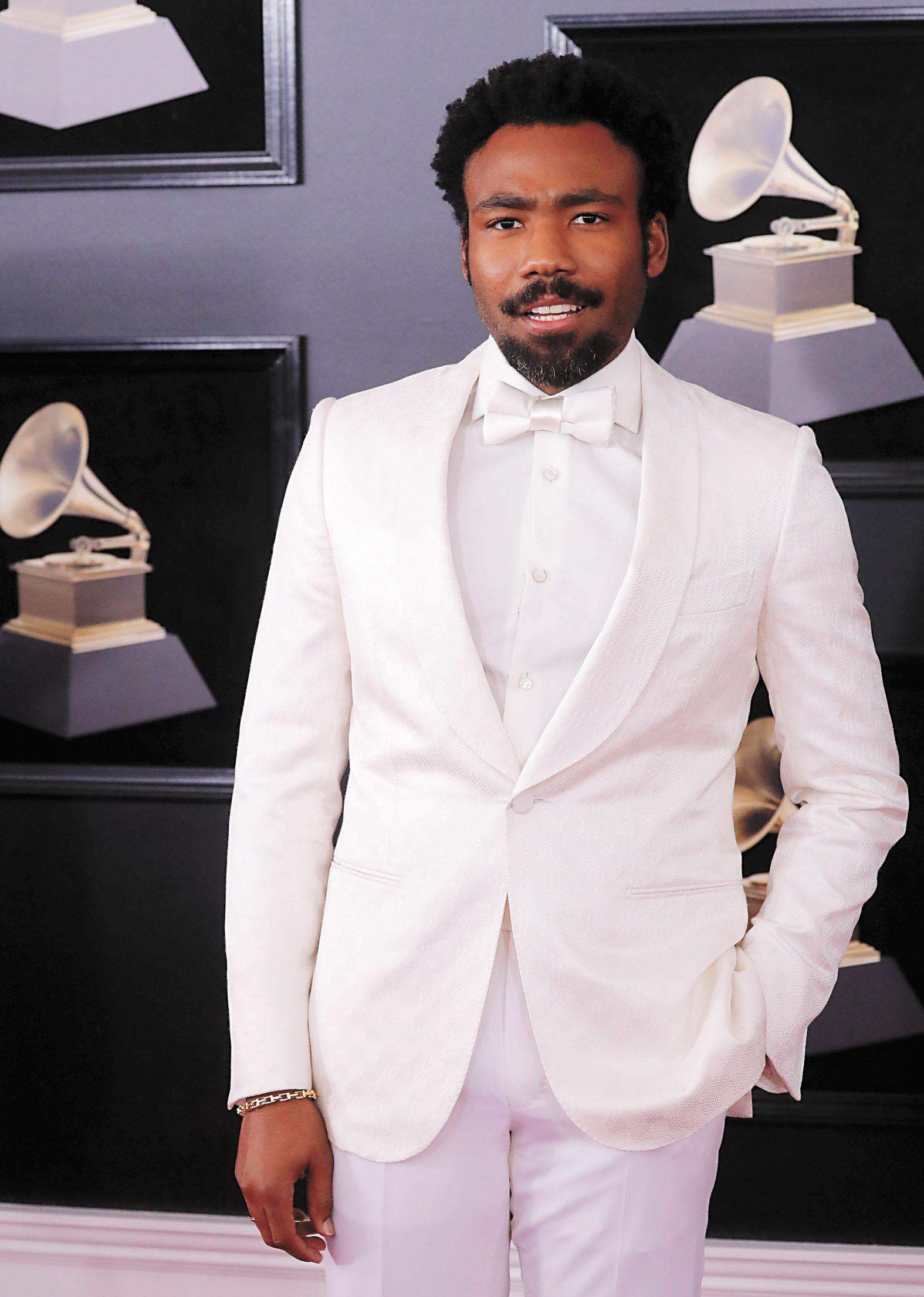 饒舌歌手「淘氣阿甘」打敗多名勁敵獲得年度最佳歌曲等獎項。他未有到場領獎,圖為他去年出席格萊美。路透社資料圖片