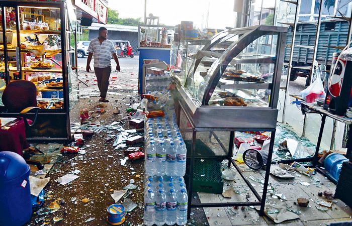 斯里蘭卡爆反穆斯林暴亂,米努萬戈德一家商店遭破壞。 法新社