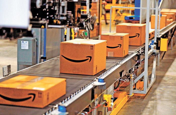 ■為加快訂單處理速度,亞馬遜正計劃通過自動打包機器。法新社