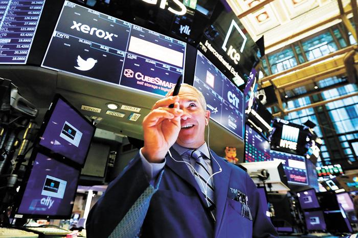14日美股走勢回穩,道瓊指數勁揚207點,創一個月來最佳表現。美聯社