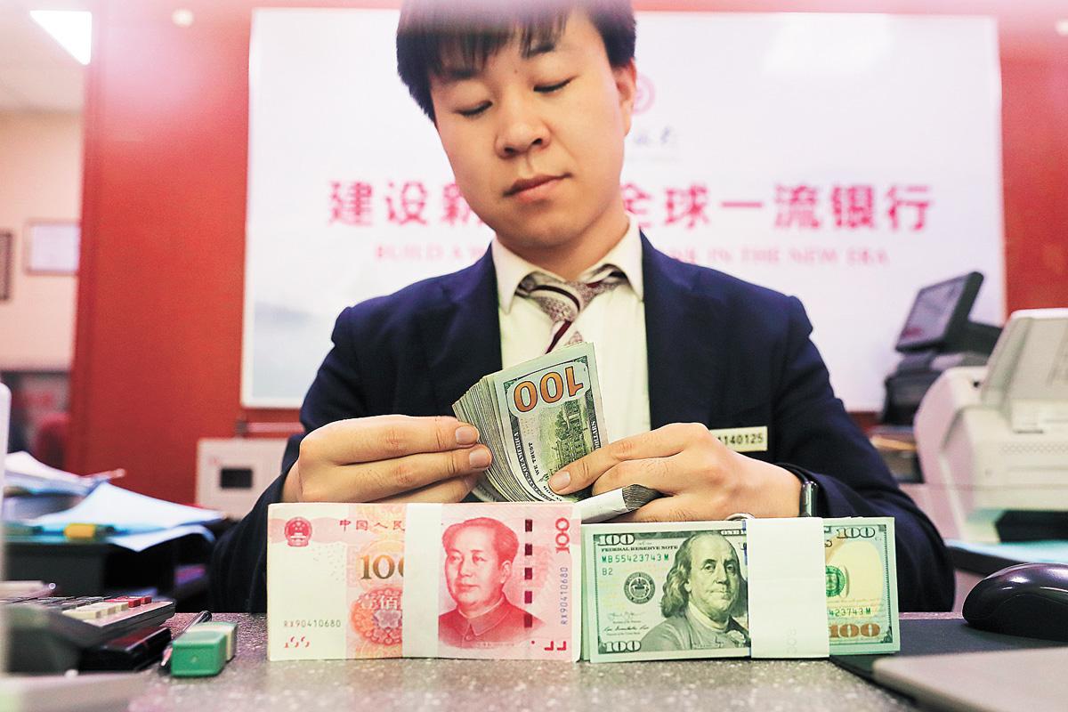 過去多年,人民幣匯率一直是美中摩擦來源之一。資料圖片
