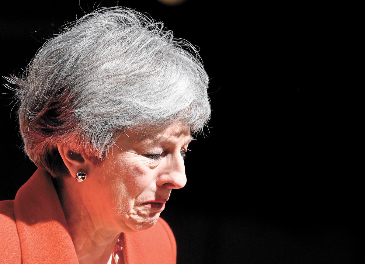 文翠珊宣布辭職時強忍淚水。路透社