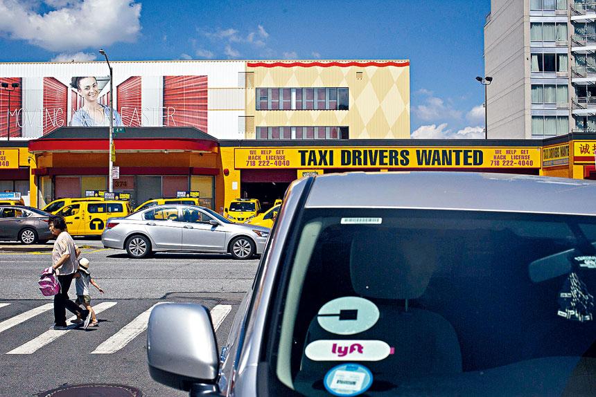 市府提出為網召車發牌設限,以解決行業競爭及道路擁擠的問題。Dave Sanders/紐約時報