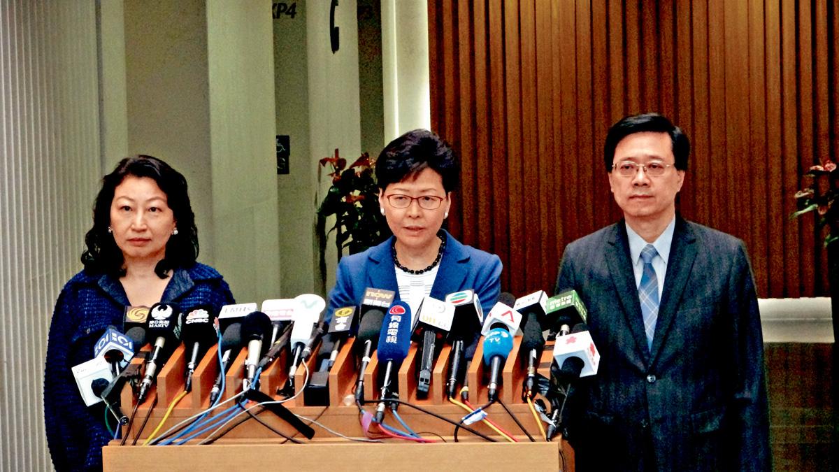 林鄭月娥(中)表明修例有其必要,港府將推出四項措施向社會釋疑。楊偉亨攝