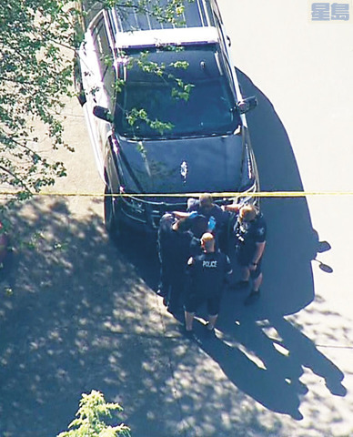 連頓市槍案現場,警方將兇嫌拘捕。電視截圖