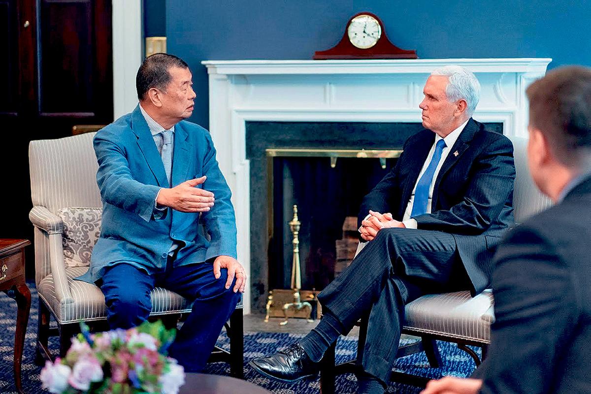 美國副總統彭斯會見壹傳媒創辦人黎智英(左)。