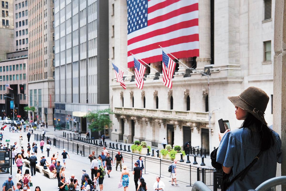 道指與標普五百指數11日均創歷史最高收市紀錄。法新社