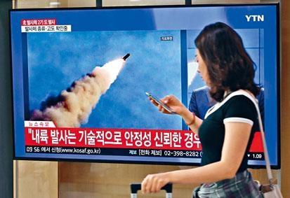 首爾火車站大電視周二播放北韓導彈資料片段。