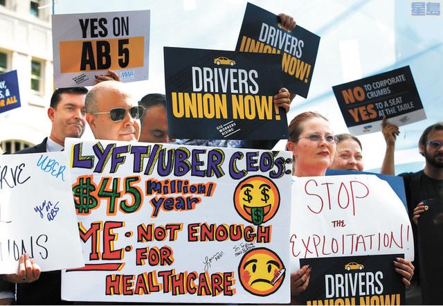 網的司機和工會團體早前大力支持AB 5法案。美聯社資料圖片