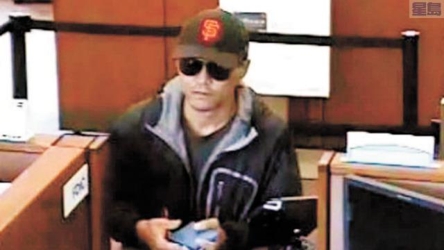 磨坊谷遇劫銀行拍下亞裔搶匪。磨坊谷警察局