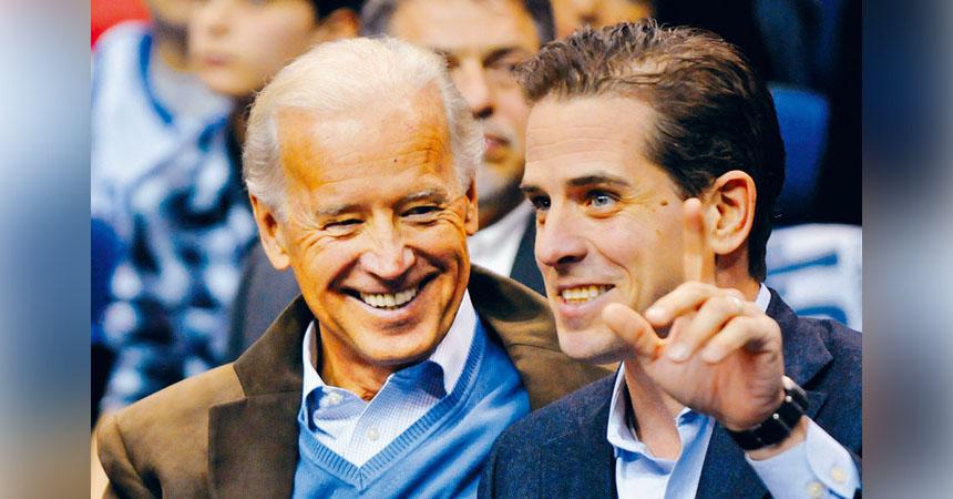 民主黨總統參選人、前副總統拜登的兒子亨特透過律師表示,將辭任一間中國私募股權基金公司董事。圖為拜登父子。   路透社