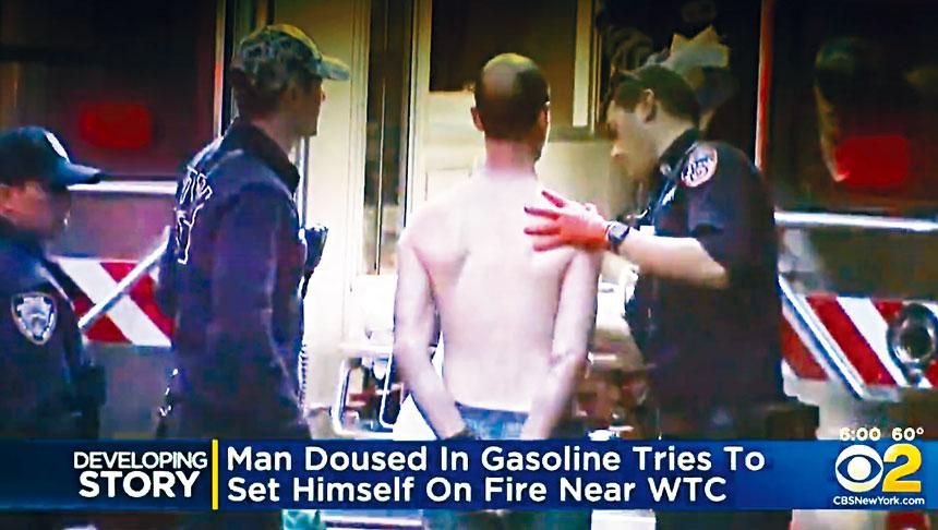 警方把企圖自焚男子逮捕。CBS新聞截圖