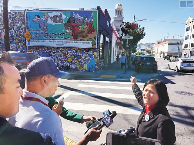 李愛晨為其「廣告牌」辯護。記者徐明月攝