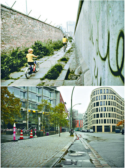 一九八一年七月,一對父子在圍牆之間的空隙踏單車(上圖)。同一位置現今變成街道(下圖)。 美聯社