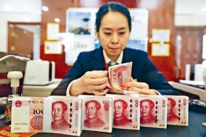 人民幣持續一周揚升後,昨日失守七算,在岸人民幣一度低見7.0118。