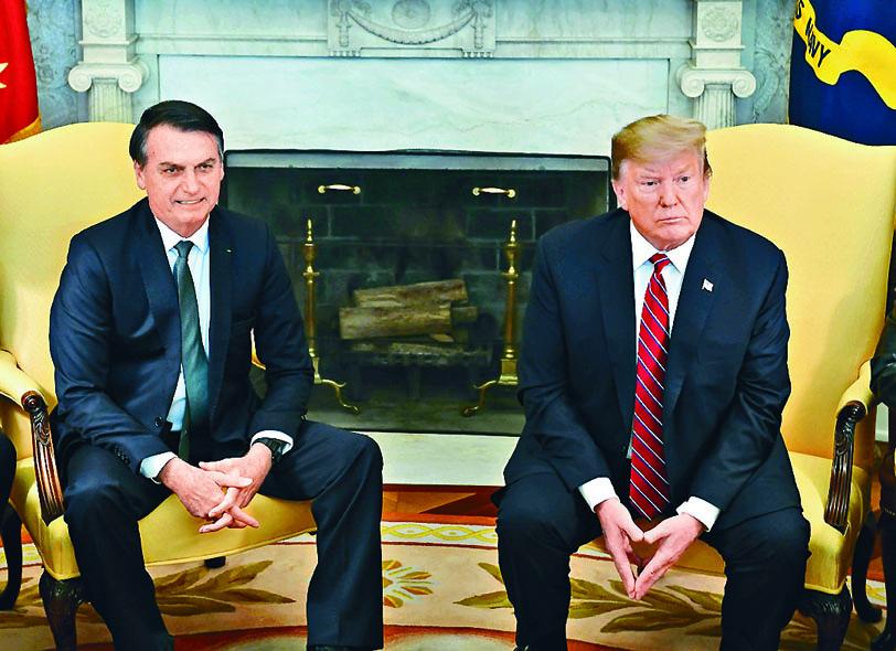 特朗普三月在白宮接見到訪的巴西總統博爾索納羅。