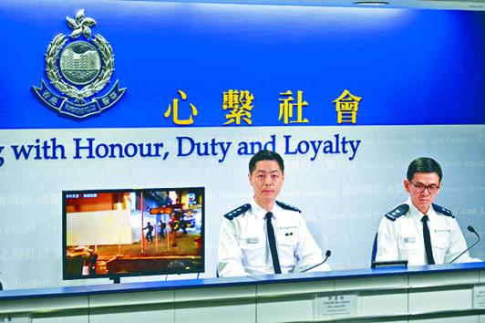 警察公共關係科總警司郭嘉銓(左),希望巿民不要縱容暴力。