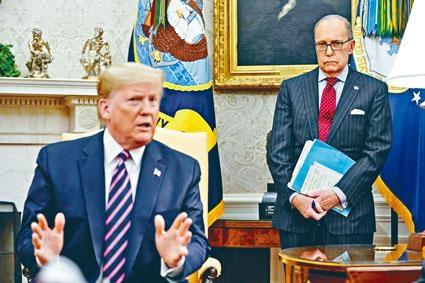 白宮經濟顧問庫德洛(右)表示,首階段貿易協議的中英文本及簽約儀式已準備就緒,背景說明資料及翻譯內容將於周三公布。