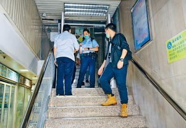 中旅社門口被擲汽油彈,警方封鎖門口梯間調查。