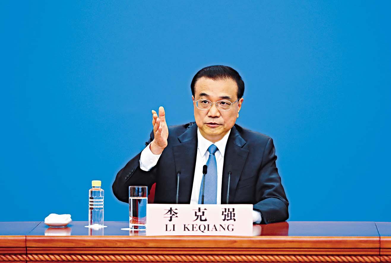 總理李克強昨天在人民大會堂 回答中外記者提問。 新華社