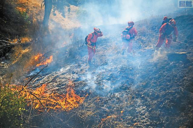 州政府計劃僱用臨時消防員和全職消防員,確保有足夠人手,應對山火季度。美聯社