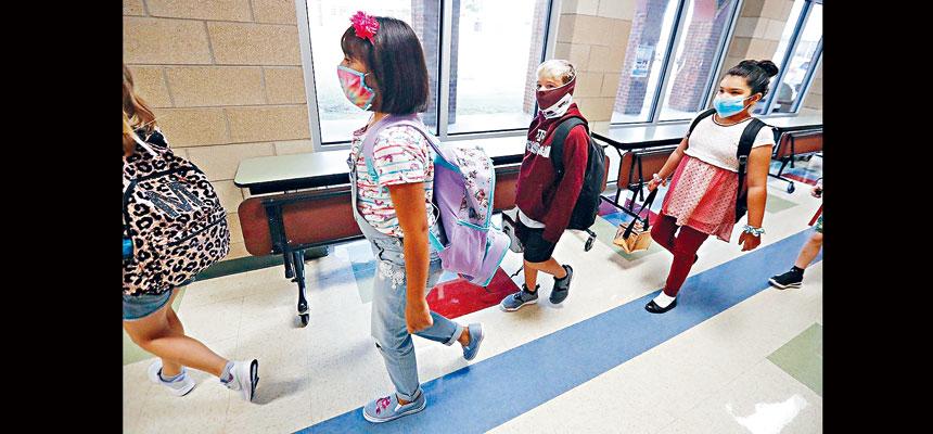 在各地學校準備重開或剛開始重開之時,報告指,最近兩周證實感染新冠病毒的兒童接近10萬,升幅高達40%。美聯社