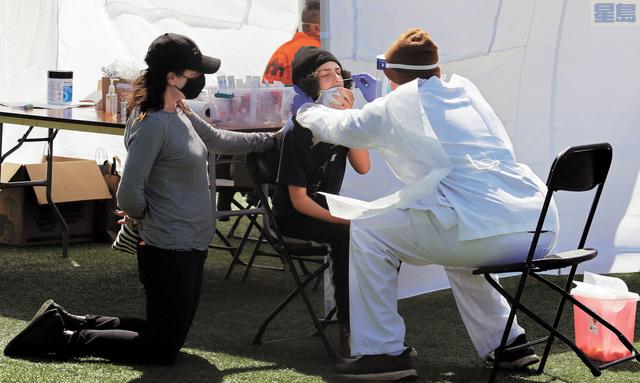 截至周四,加州已經近53萬人確診。美聯社資料圖片