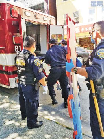 嫌疑人被送上救護車。圖片由彭德慧提供