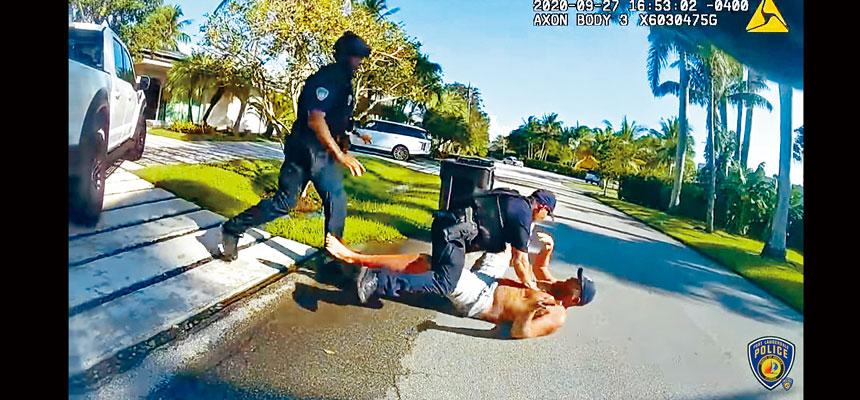 佛州勞德代爾堡警局發布的視頻顯示,特朗普的前競選經理帕斯卡爾(地上)在他的家外被捕。報告指帕斯卡爾的講話含糊不清,好像喝醉酒。法新社