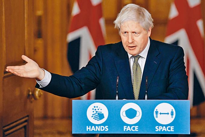 英國首相約翰遜周一在首相府,召開網上疫情記者會。