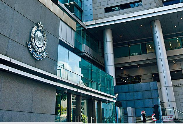 七男女涉與上市公司造假帳案有關,昨被警方商業罪案調查科人員拘捕。