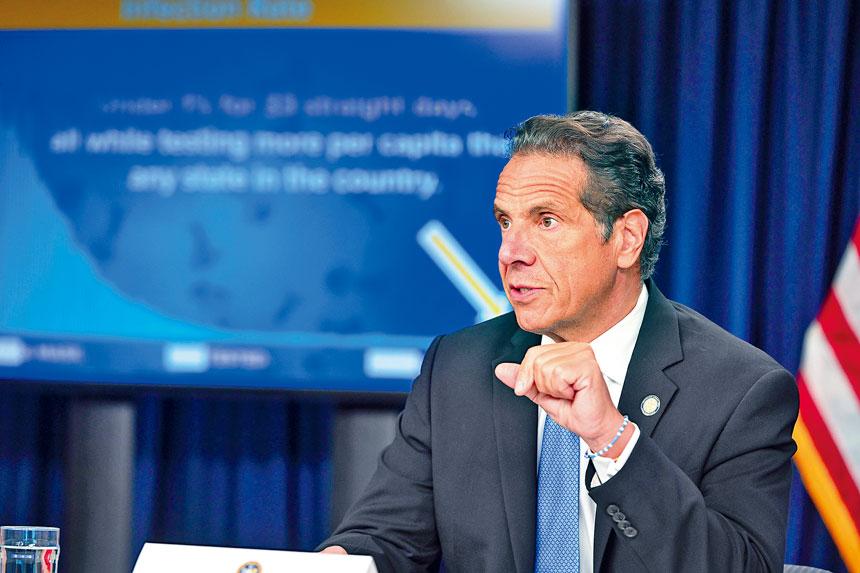 柯謨的新冠疫情簡報會令人留下深刻印象。 州長辦公室Flickr圖片