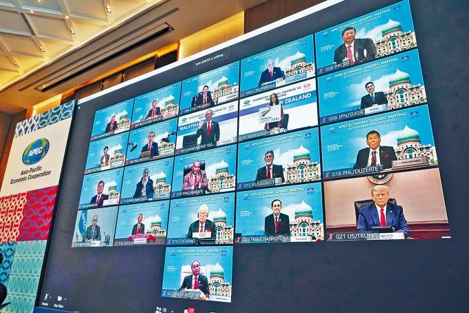 特朗普(右下)和習近平(右上)昨出席APEC視像峰會。