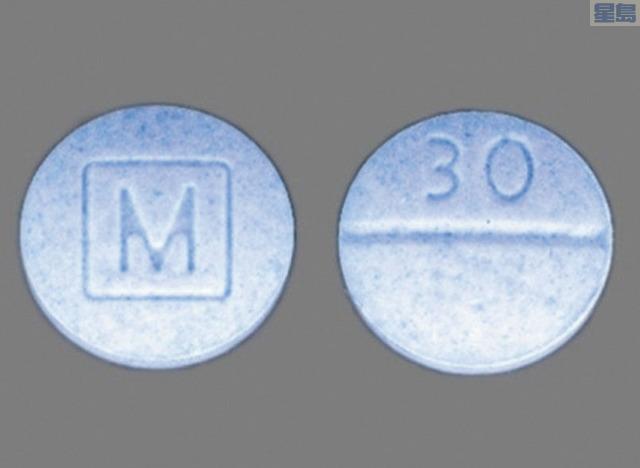 含芬太尼藥物顆粒,一面有M字樣,另一面有30數字。聖他克拉縣縣府