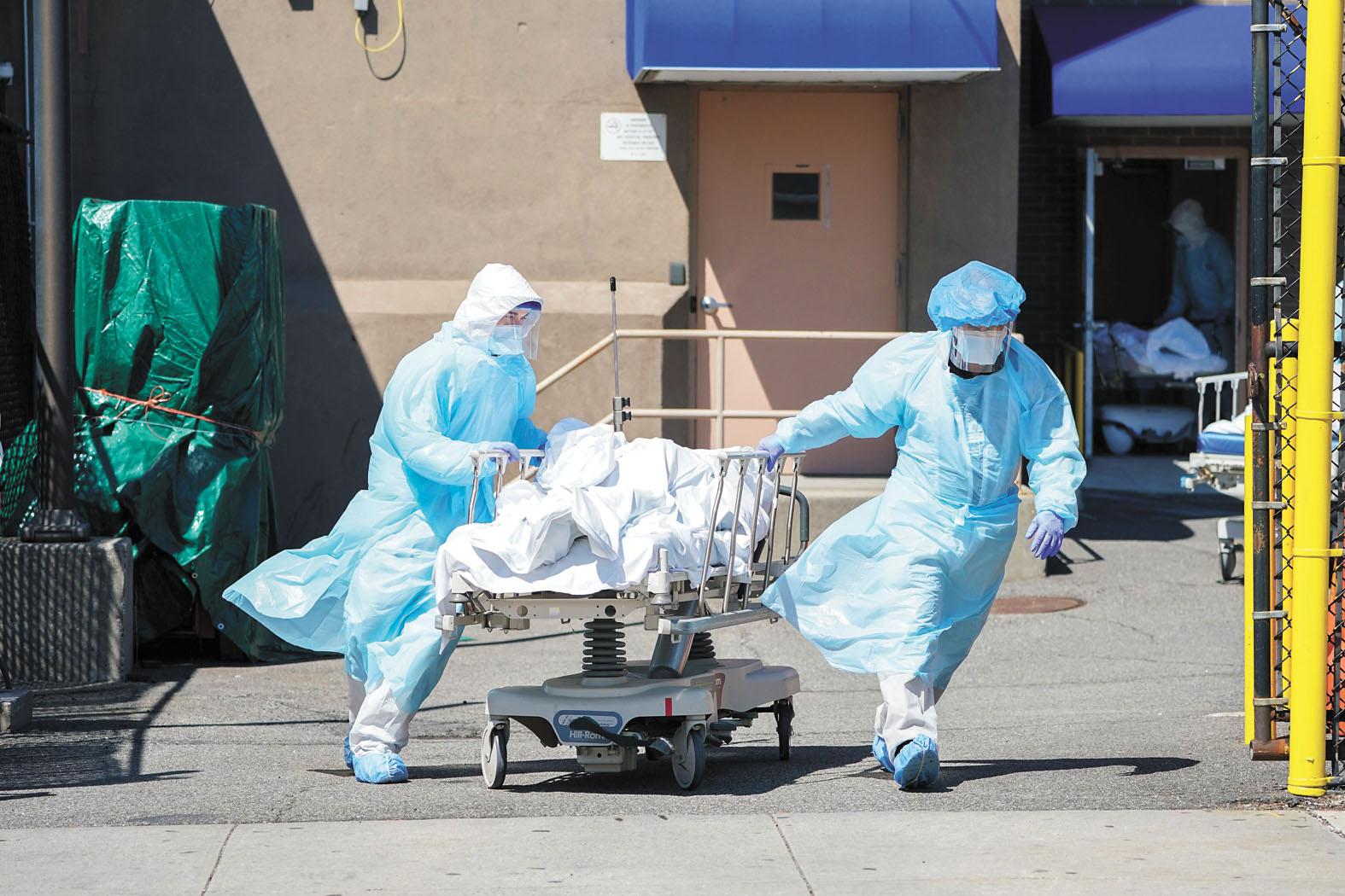 美國新冠肺炎死亡人數超過27萬人,停屍房、殯儀館和醫院都不堪重負。法新社