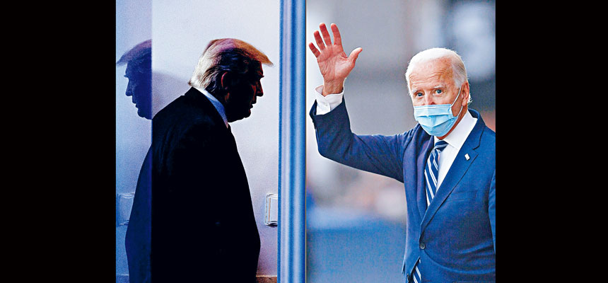 候任總統拜登(右)20日將宣誓就任,另外,消息透露,總統特朗普(左)會在當日早上離開華盛頓,他的送別儀式將在安德魯斯空軍基地舉行。法新社