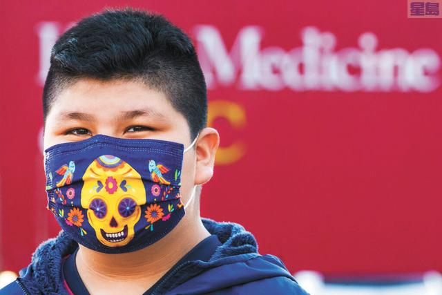 口罩對於預防感染病毒作用很大。美聯社