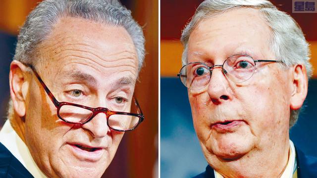 ■剛奪得參議院控制權的民主黨領袖舒默(左)和共和黨領袖麥康諾(右)在討論權力分享協議時,發生齟齬,阻礙議會新會期的工作進程。    美聯社