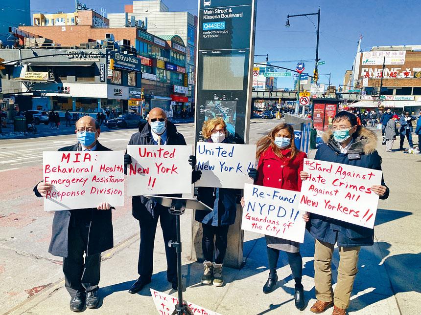 各個族裔的社區人士於21日在法拉盛集會,譴責襲擊亞裔事件,並呼籲改善保釋金改革制度。
