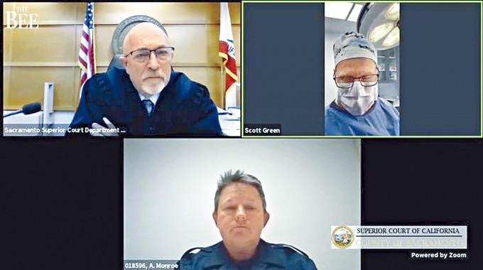 格林(右上)替病人動手術時,透過Zoom視像系統出席聆訊。