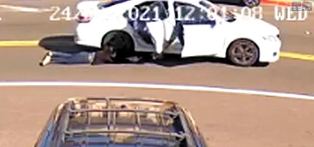 24日中午,華埠九街附近發生劫案,為了奪回手袋,女事主被車子拖在地上。記者張曼琳截屏