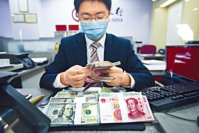 中國2月外匯儲備約3.2萬億美元,按月減少57億美元或0.18%,錄得兩連跌。