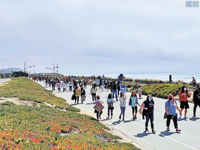 參與集會群眾沿著Great Highway大遊行。        馬兆明辦公室提供