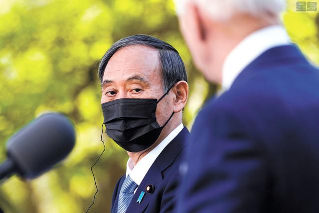 日本首相菅義偉16日會見拜登總統。美聯社