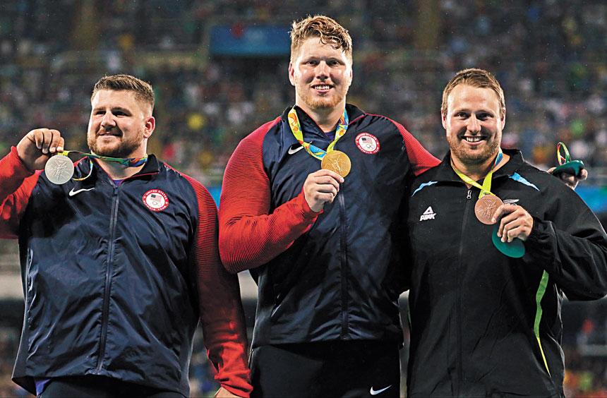克魯瑟(中)在里約奧運會奪冠。資料圖片
