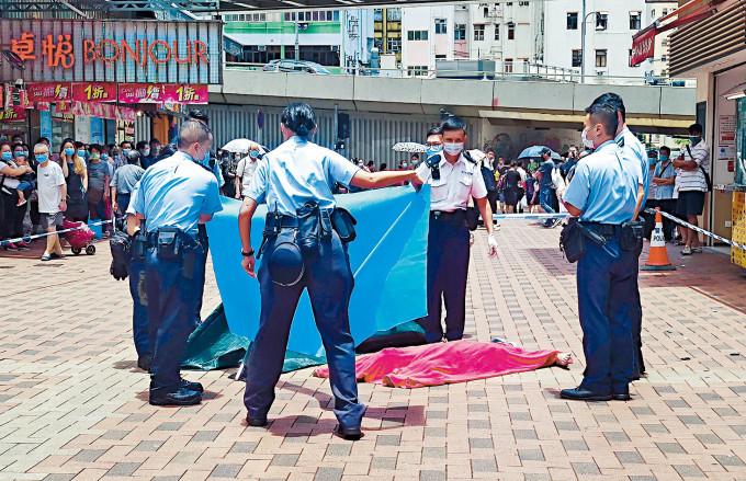 髮型師墮樓喪生,警方用帳篷蓋屍調查。